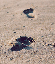 footsteps on sand - beach