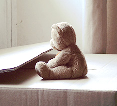 μοναξιά - loneliness -- teddy bear sitting in paper box
