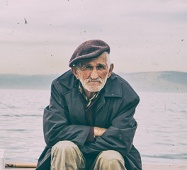 sad old man sit sea