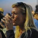 A woman enjoys a drink